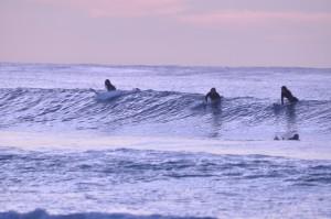 Sunset surfers at Long Beach Kommetjie